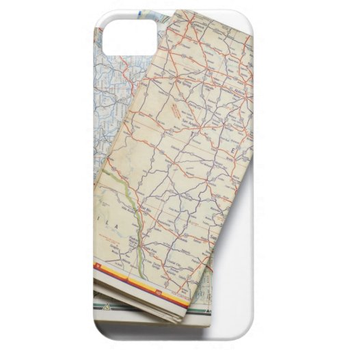 A stack of folded road maps on a white iPhone 5 cover