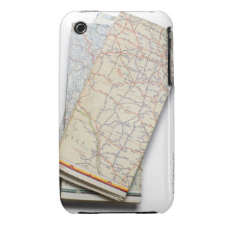 A stack of folded road maps on a white iPhone 3 case