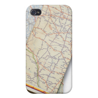 A stack of folded road maps on a white iPhone 4/4S case