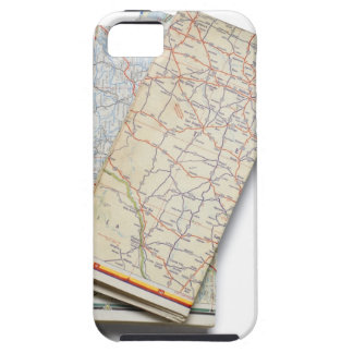 A stack of folded road maps on a white iPhone SE/5/5s case