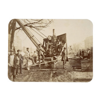 A steam crane in operation during the building of rectangular photo magnet