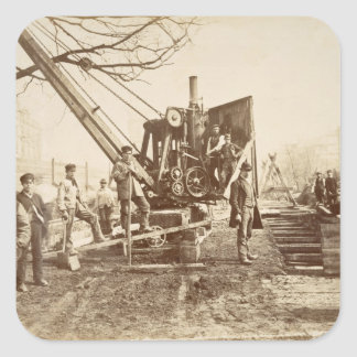 A steam crane in operation during the building of square sticker