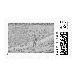 A stick figure stamps