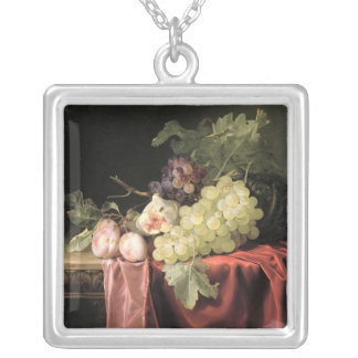 A still life with grapes, plums silver plated necklace