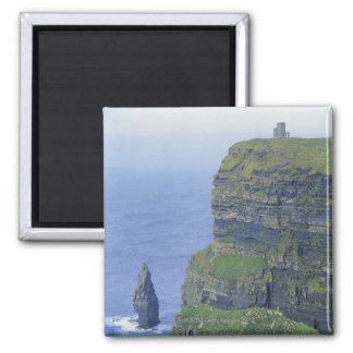 a stone castle standing on top a steep cliff in 2 inch square magnet