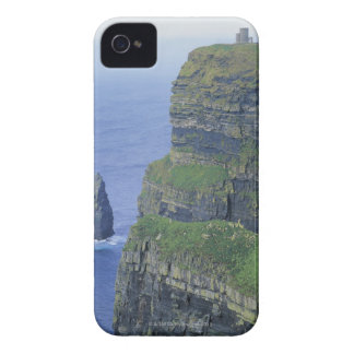 a stone castle standing on top a steep cliff in iPhone 4 covers