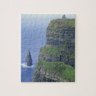 a stone castle standing on top a steep cliff in jigsaw puzzle