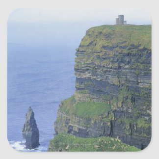 a stone castle standing on top a steep cliff in sticker