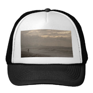 A stormy day at the beach trucker hat