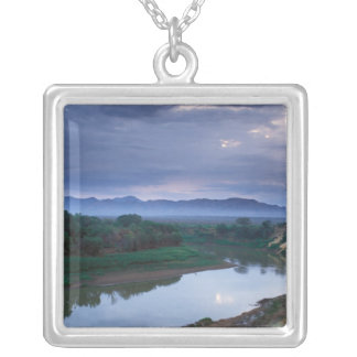 A stormy morning, with threatening clouds silver plated necklace