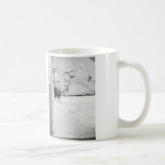 A struggling weed on concrete steps coffee mug
