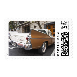 A Studebaker Silver Hawk Classic Car parked on a Stamp