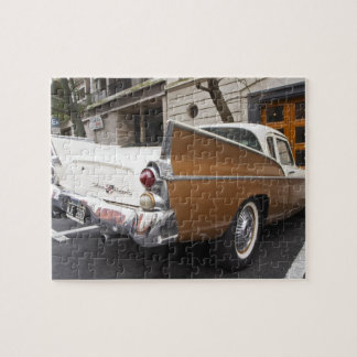 A Studebaker Silver Hawk Classic Car parked on a Puzzle