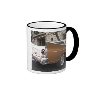 A Studebaker Silver Hawk Classic Car parked on a Ringer Mug