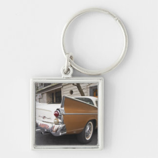 A Studebaker Silver Hawk Classic Car parked on a Silver-Colored Square Keychain