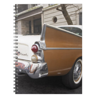 A Studebaker Silver Hawk Classic Car parked on a Spiral Notebook