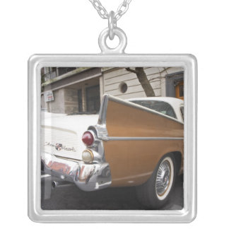 A Studebaker Silver Hawk Classic Car parked on a Square Pendant Necklace