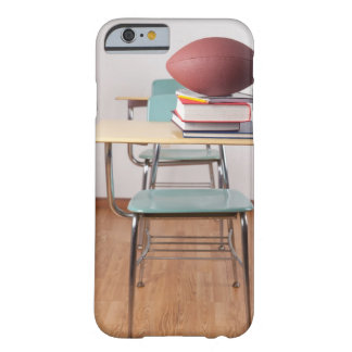 A student desk with a football sitting on a pile barely there iPhone 6 case