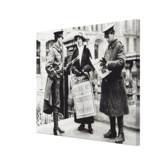 A Suffragette selling newspapers to two Canvas Print