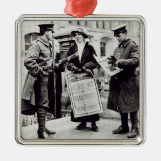 A Suffragette selling newspapers to two Christmas Tree Ornament