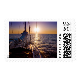 A sunset at sea from yacht desk postage