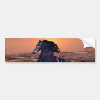 A sunset ocean horse bumper sticker