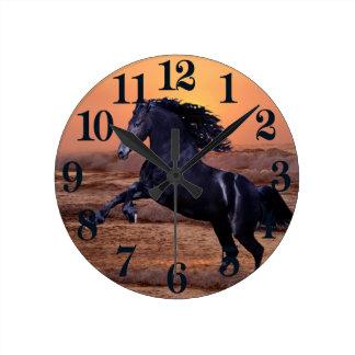 A sunset ocean horse round clock