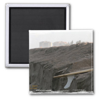 A surfboard sits on the beach in Florida on cliff 2 Inch Square Magnet