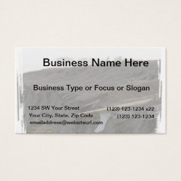 A surfboard sits on the beach in Florida on cliff Business Card