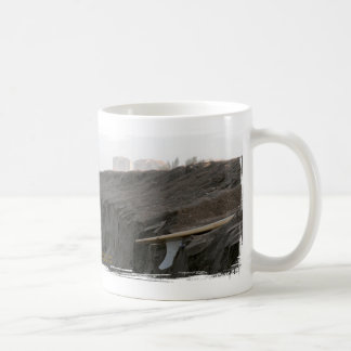 A surfboard sits on the beach in Florida on cliff Classic White Coffee Mug