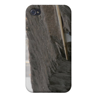 A surfboard sits on the beach in Florida on cliff iPhone 4 Covers