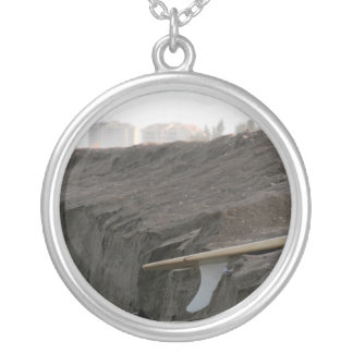 A surfboard sits on the beach in Florida on cliff Silver Plated Necklace