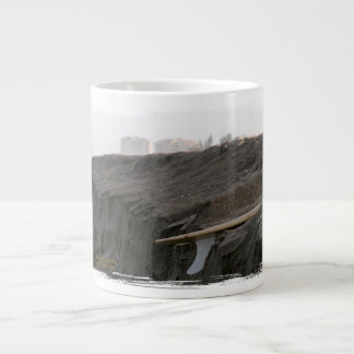 A surfboard sits on the beach in Florida on cliff 20 Oz Large Ceramic Coffee Mug