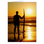 A surfer watching the waves card