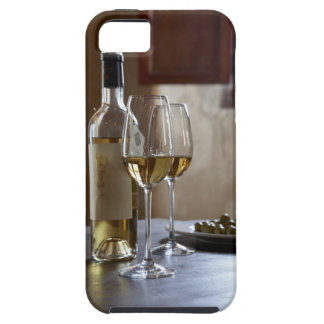 A table with bottle and two glasses of Spanish iPhone 5 Cover