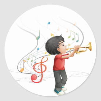 A talented young boy playing with the trumpet stickers