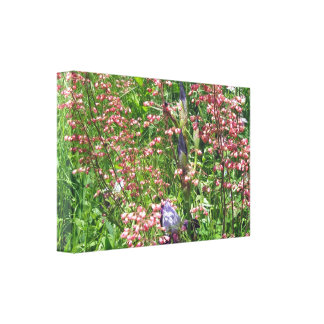 A Tangle Of Coral Bells And Irises Canvas Print