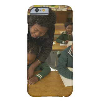 A teacher assists young schoolchildren in her barely there iPhone 6 case