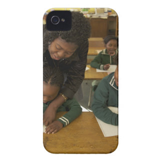 A teacher assists young schoolchildren in her Case-Mate iPhone 4 case