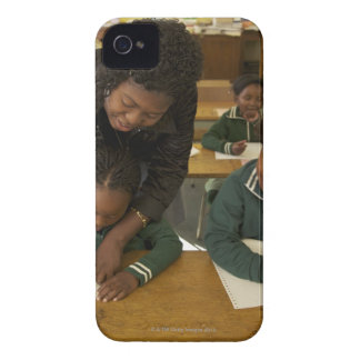 A teacher assists young schoolchildren in her iPhone 4 cover