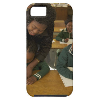 A teacher assists young schoolchildren in her iPhone SE/5/5s case