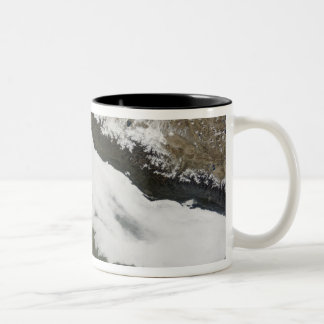 A thick bank of low clouds Two-Tone coffee mug