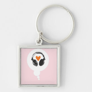 A thought bubble with a heart and headphones keychain