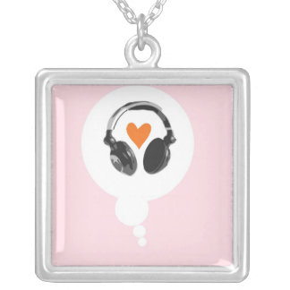 A thought bubble with a heart and headphones pendants