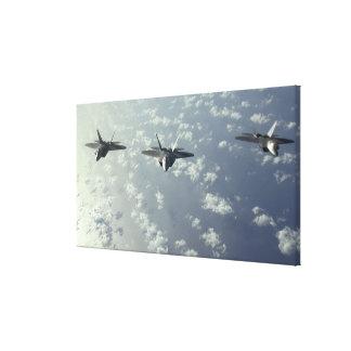 A three-ship formation of F-22 Raptors Canvas Print