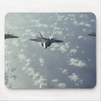 A three-ship formation of F-22 Raptors Mouse Pad