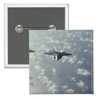 A three-ship formation of F-22 Raptors Pinback Button