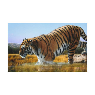 A Tiger wading into water Canvas Print