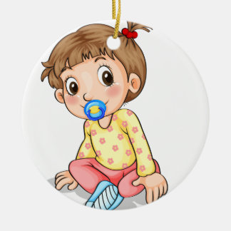 A toddler with a pacifier ceramic ornament