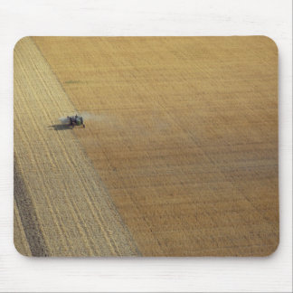 A tractor harvesting mouse pad